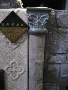 closeup of column capital, wallpaper and tile