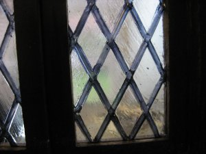 antique effect glass in Jacobean style window