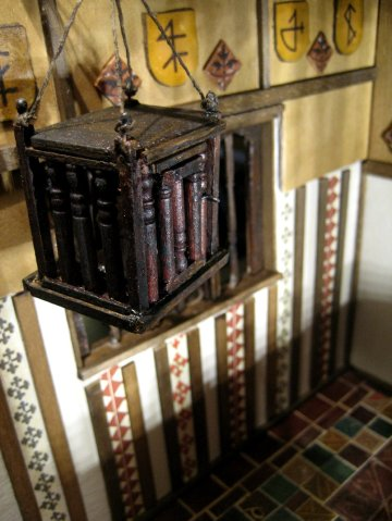 theinfill – the infill – Tudor, Elizabethan, Jacobean Dolls House Blog – Front Porch internal dressing - hanging food cradle