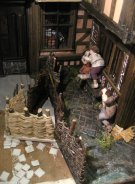 theinfill dolls house blog - Medieval, Tudor, Jacobean 1:12 dolls house – Porch working on the other side - building up the outside 'street' - hurdles for sheep etc