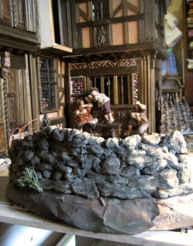 theinfill dolls house blog - Medieval, Tudor, Jacobean 1:12 dolls house – Porch working on the other side - building up the outside 'street' - attempts at landscaping