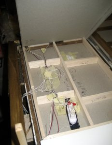 open loose box lid to reveal protected spaghetti wiring