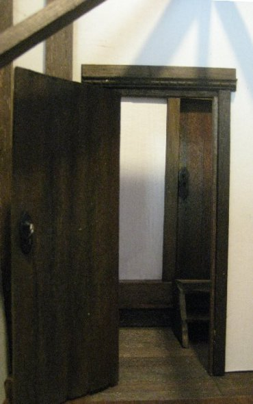 theinfill dolls house blog - open cardboard door and view through