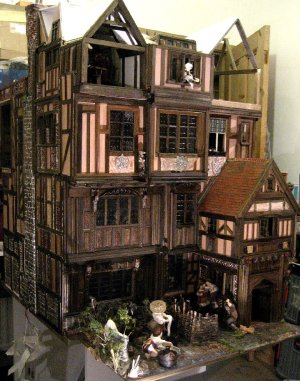 theinfill Medieval, Tudor, Jacobean 1:12 dolls house blog - the infill dolls house blog – the girl at the window throwing out the waste - view of the left side and front of house