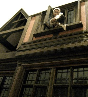 theinfill Medieval, Tudor, Jacobean 1:12 dolls house blog - the infill dolls house blog – the girl at the window throwing out the waste - view from below