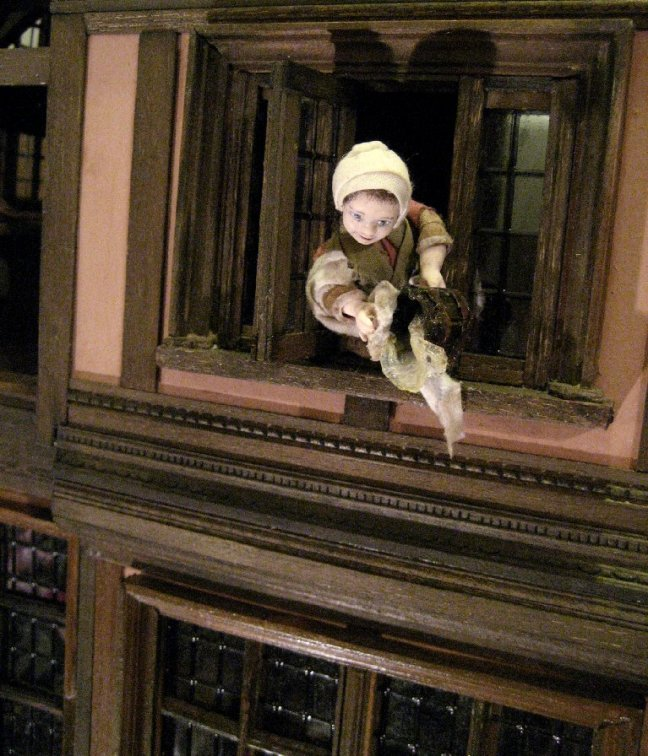 theinfill Medieval, Tudor, Jacobean 1:12 dolls house blog - the infill dolls house blog – the girl at the window throwing out the waste - front view of twisting position of figure