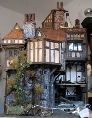 theinfill Medieval, Tudor, Jacobean dolls house blog - Hogepotche Hall –Hodgepodge Hall – back view of house where men are working