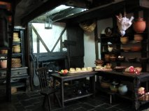 theinfill Medieval, Tudor, Jacobean dolls house blog - Hogepotche Hall –Hodgepodge Hall - main kitchen table and shelves in the work area