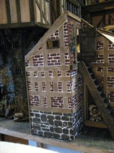 theinfill dolls house blog Hogepotche Hall –Hodgepodge Hall - a Medieval, Tudor, Jacobean dolls house blog - dairy with child on doorstep