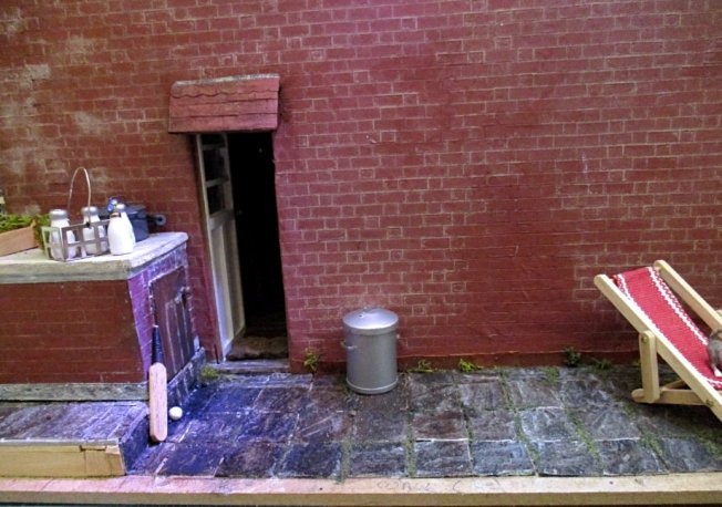 theinfill art deco dolls house blog, theinfill dolls house blog, theinfill 1930s-50s Deco House, Hogepotche Hall –Hodgepodge Hall - Medieval Tudor Jacobean dolls house blog - side path and toys and milk delivery