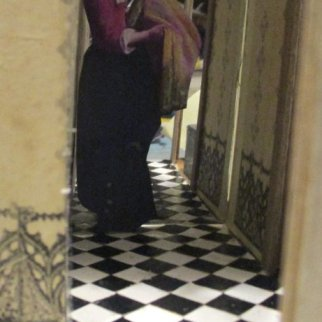 A corridor that isn't really there with a figure in it